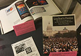 two books and one pamphlet from display on emergence of AIDS in 1980s