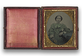 antique photo case with overpainted photo of a woman in a blue dress