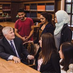 Eric Barron with students at the library